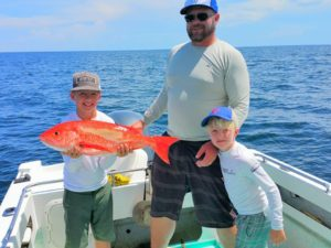 Marc Correll and kids with Red Snapper