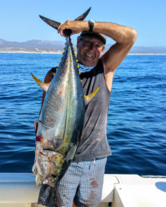 Mike Vos Sr. With his 3rd 50 lb Yellowfin Tuna brought in before 9:30am on The Maria Teresa